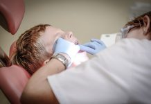 Children in pain waiting half a year for dental operations up 50%, labour warns